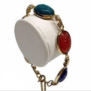 Vtg Egyptian revival carved glass scarab bracelet